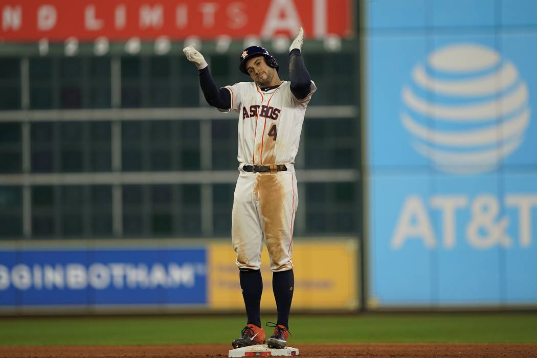 Houston Astros' George Springer reacts after hitting an RBI double during the eighth inning of ...
