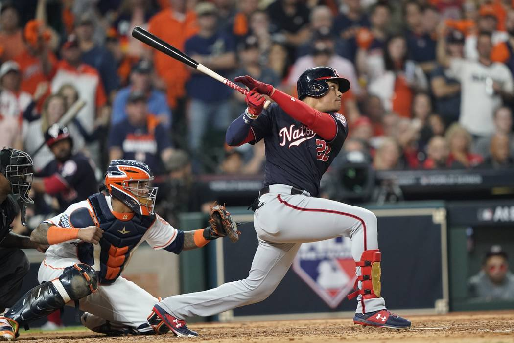 Washington Nationals' Juan Soto hits a two-run scoring double during the fifth inning of Game 1 ...