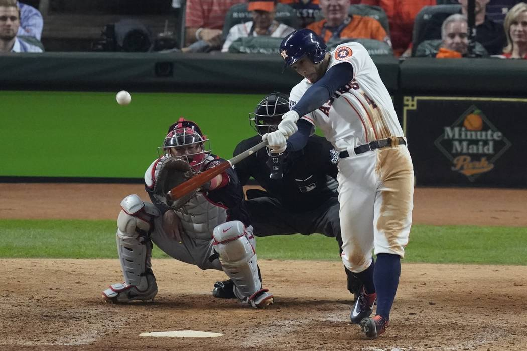Houston Astros' George Springer hits an RBI double during the eighth inning of Game 1 of the ba ...