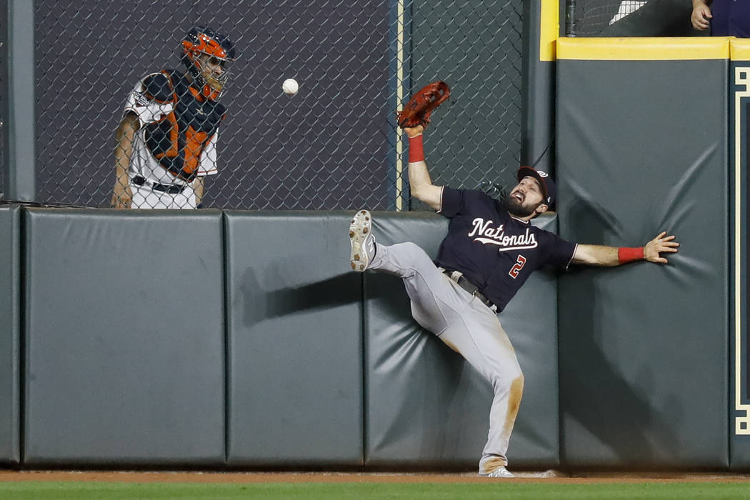 Washington Nationals right fielder Adam Eaton can't get a glove on a RBI-double by Houston Astr ...