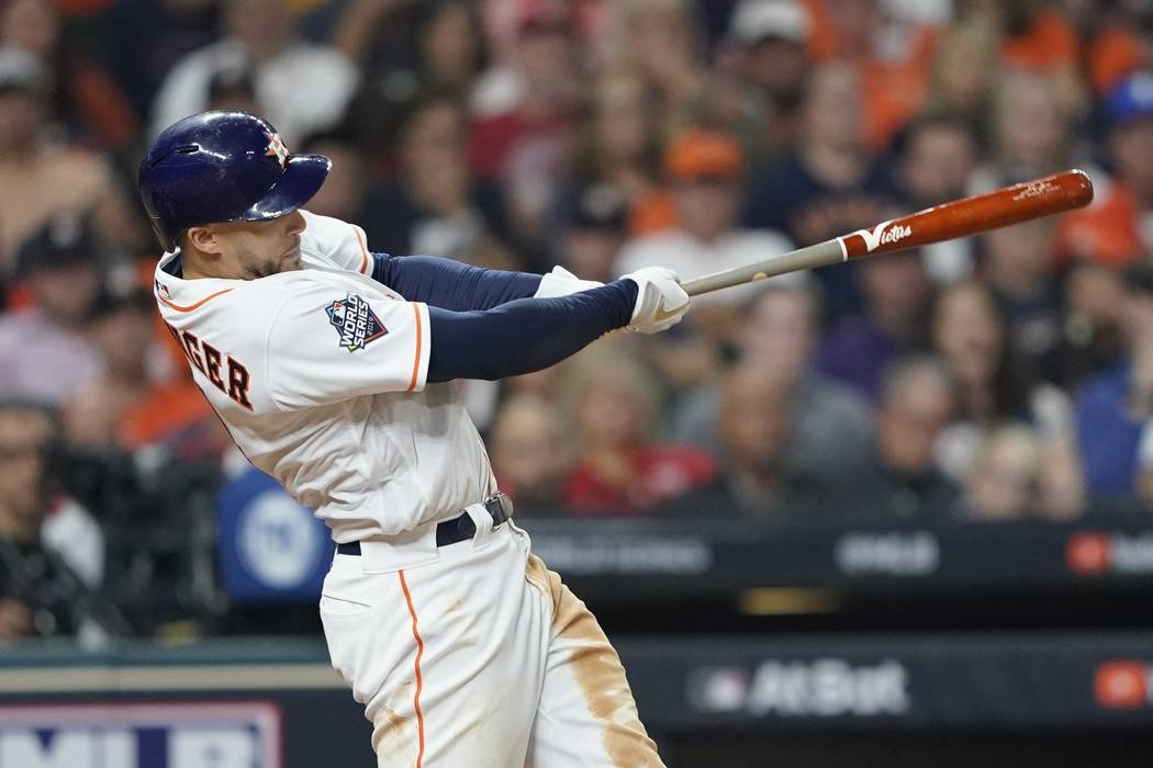 Houston Astros' George Springer hits a home run during the seventh inning of Game 1 of the base ...