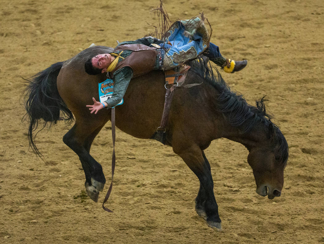 Bareback rider Earl Tsosie Jr. leans way back on his horse during the first round of the Indian ...