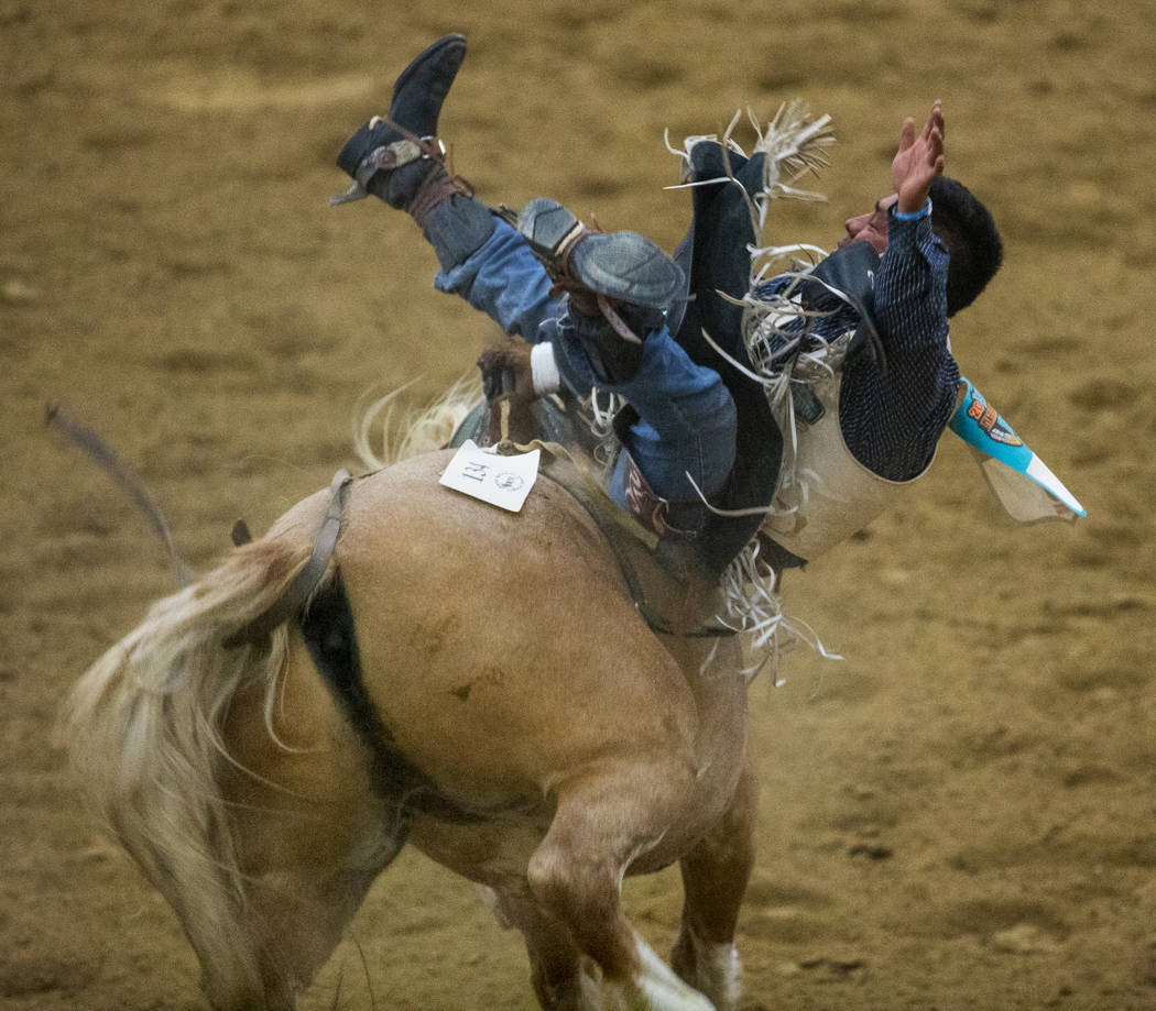 Bareback rider Delvecchio Kay ends up sideways on his horse during the first round of the India ...