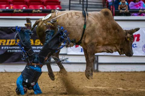 Bull rider Justin Little Plume crashes to the dirt after being thrown from his bull during the ...