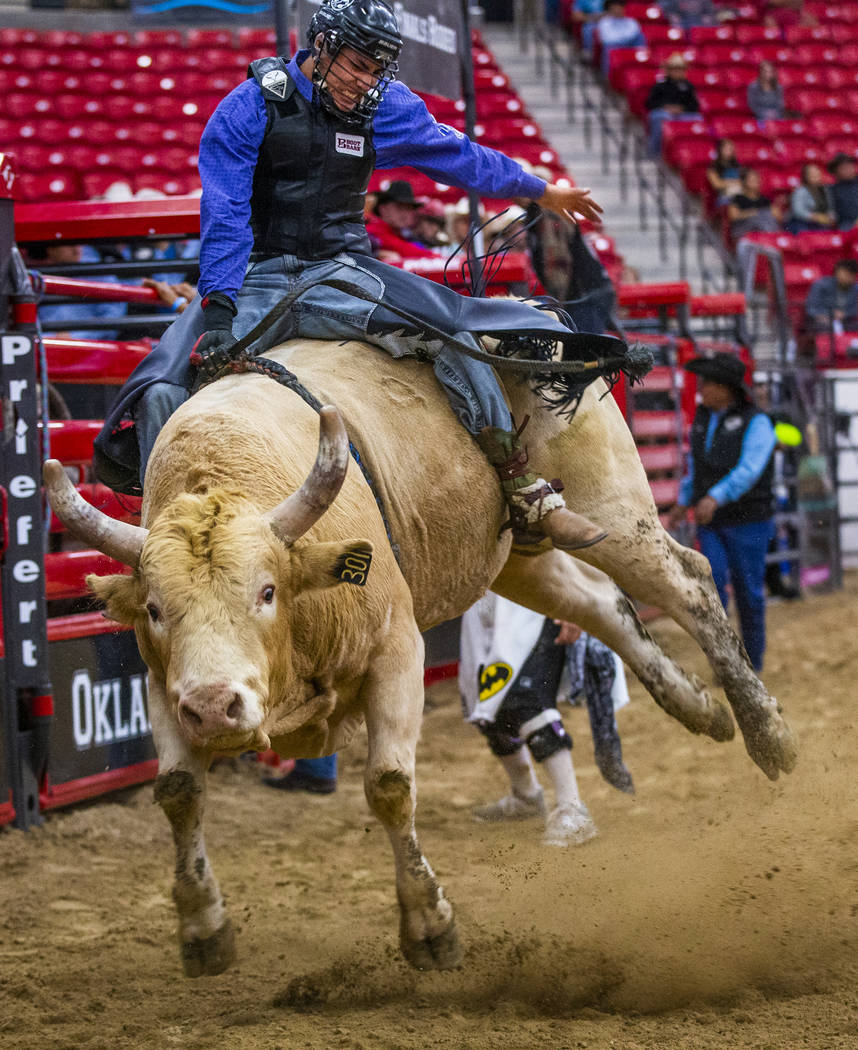 Bull rider Riel Bruised Head holds tight onto his bull during the first round of the Indian Nat ...