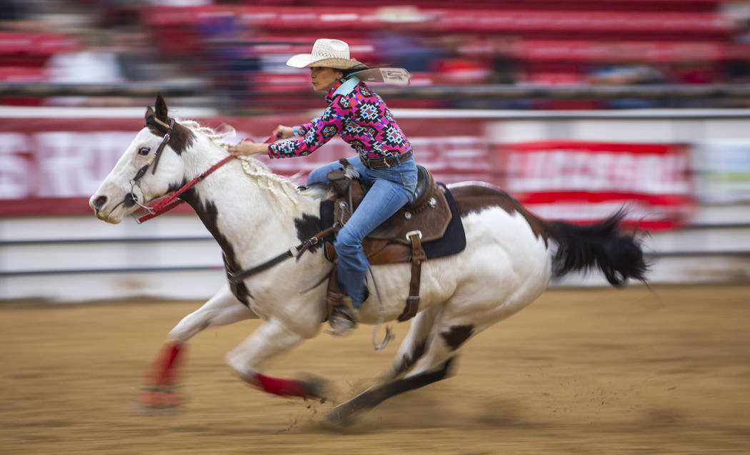 Barrel racer Karlee Meyers readies to turn her horse on the final barrel during the first round ...