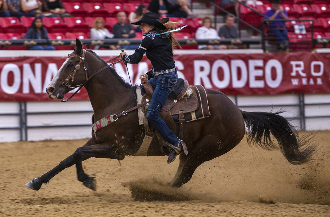 Barrel racer Sallye Williams readies to cut the barrel close with her horse during the first ro ...