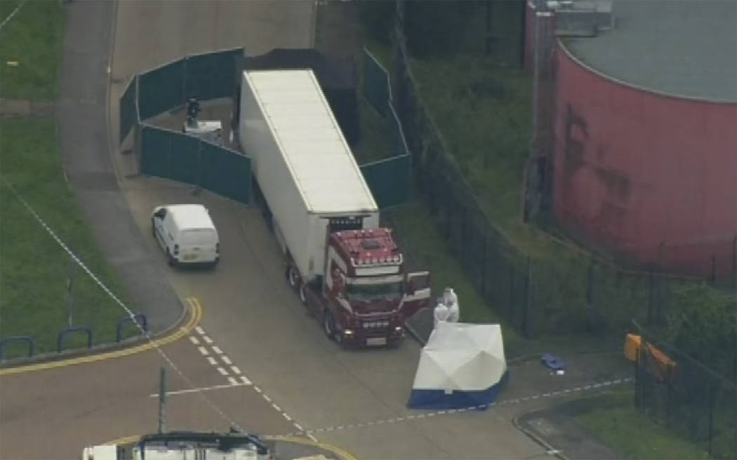 An aerial view as police forensic officers attend the scene after a truck was found to contain ...