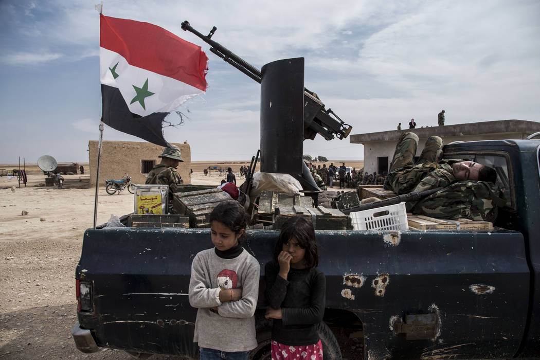 Syrian government forces deploy near the town of Tal Tamr, north Syria, Tuesday, Oct. 22, 2019. ...