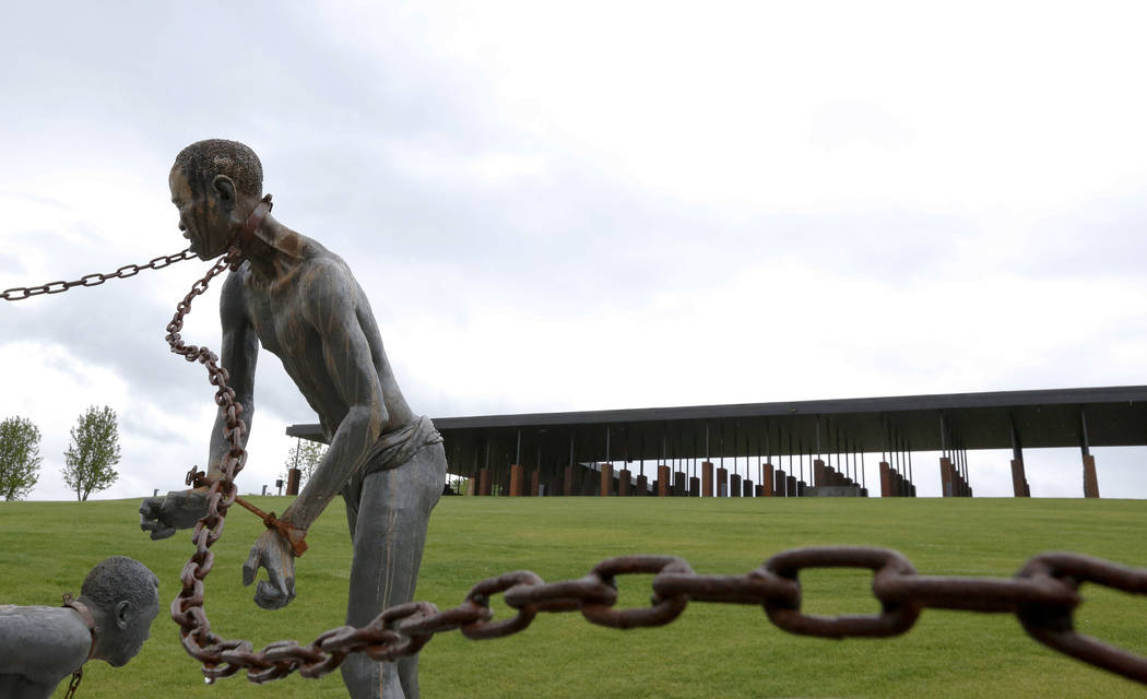 FILE - In this Sunday, April 22, 2018, file photo, a statue of a chained man is on display at t ...