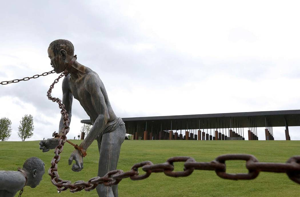 In a Sunday, April 22, 2018, file photo, a statue of a chained man is on display at the Nationa ...