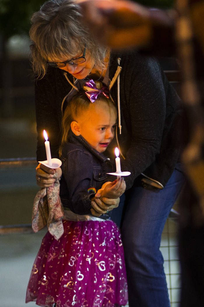 Kathleen Wheeler, above, comforts a young family member while remembering grandson, 6-year-old ...