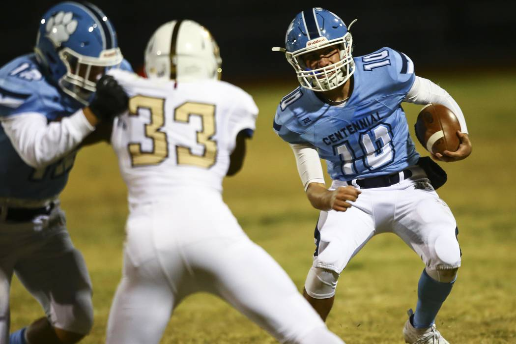 Centennial quarterback Colton Tenney (10) runs the ball against Faith Lutheran during the secon ...