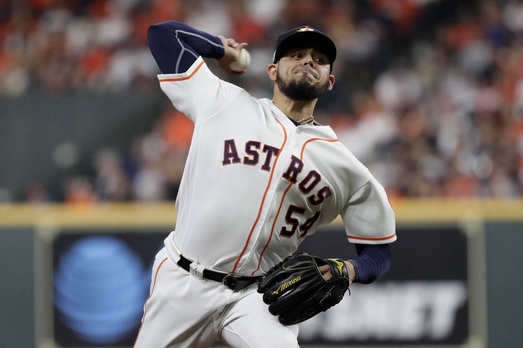 Houston Astros relief pitcher Roberto Osuna throws against the New York Yankees during the eigh ...