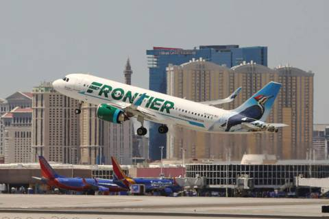 A Frontier Airlines flight departs McCarran International Airport in Las Vegas, June 26, 2019. ...