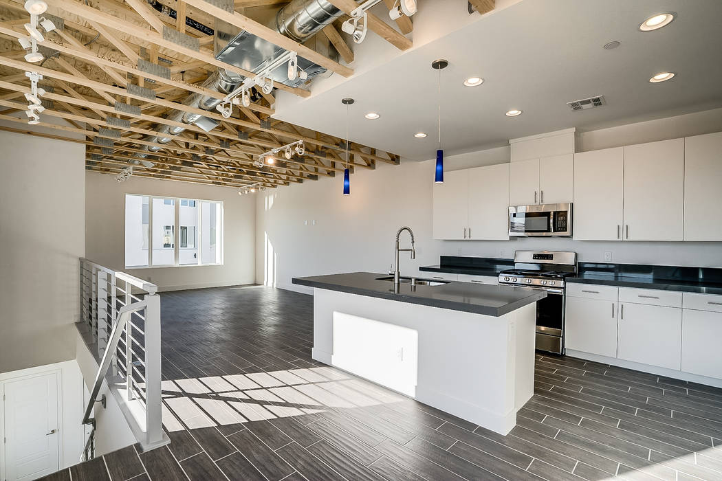 Paragon Lofts features stainless steel appliances, quartz countertops and exposed rafters in th ...