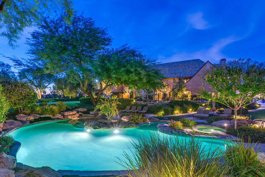 The TPC Summerlin golf course home has mature landscaping. (Fraser Almeida /Luxury Home Photogr ...