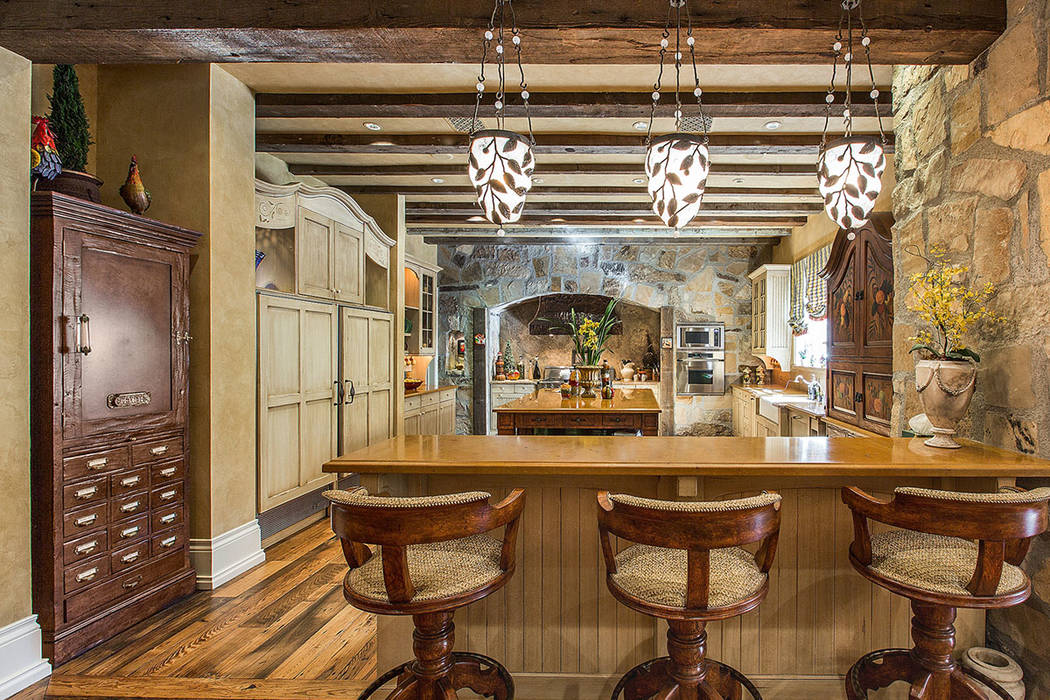 The kitchen has a French country style. (Fraser Almeida /Luxury Home Photography)