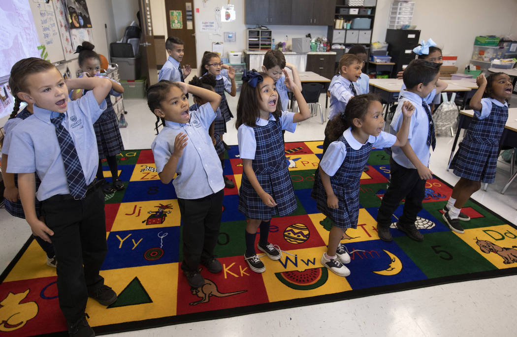 """A second grade classroom at Signature Preparatory dances to their """"morning song,"""" which aims to ..."""