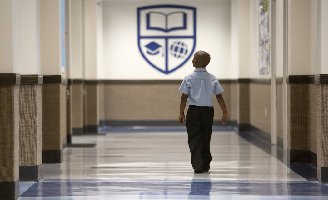 A Signature Preparatory student makes way to the restroom on Wednesday, Oct. 23, 2019, in Hende ...