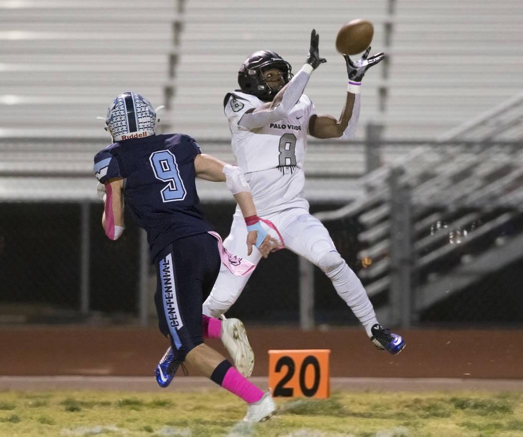 Palo Verde junior Adrian Ellis (8) pulls in a catch down the far sideline over Centennial senio ...