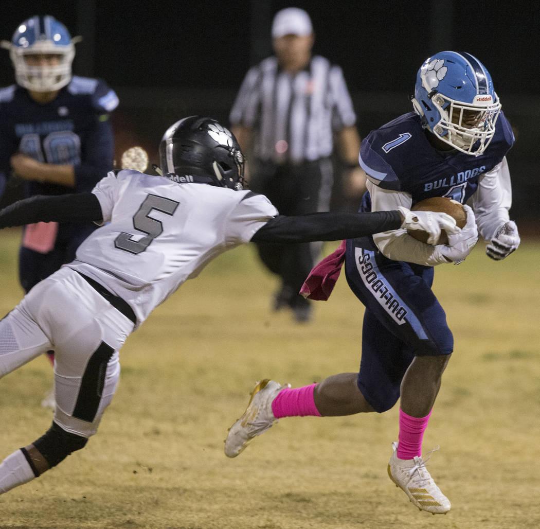 Centennial senior Jordan Smith (1) makes a move past Centennial junior Tyrone McCoy (5) in the ...