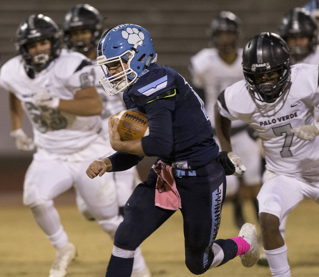 Centennial junior Colton Tenney (10) scrambles past Palo Verde senior Jayleen Mosley (7) in the ...