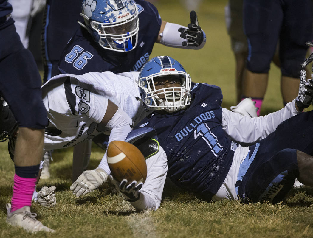 Centennial senior Jordan Smith (1) looks at the referee after Smith was called short of the goa ...