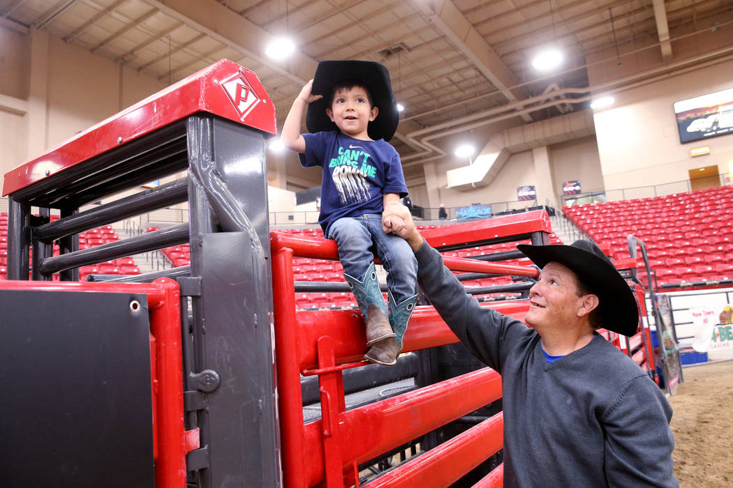 Mike Not Afraid and his grandson, Grayson Spotted Bear, 2, in the arena during Indian National ...