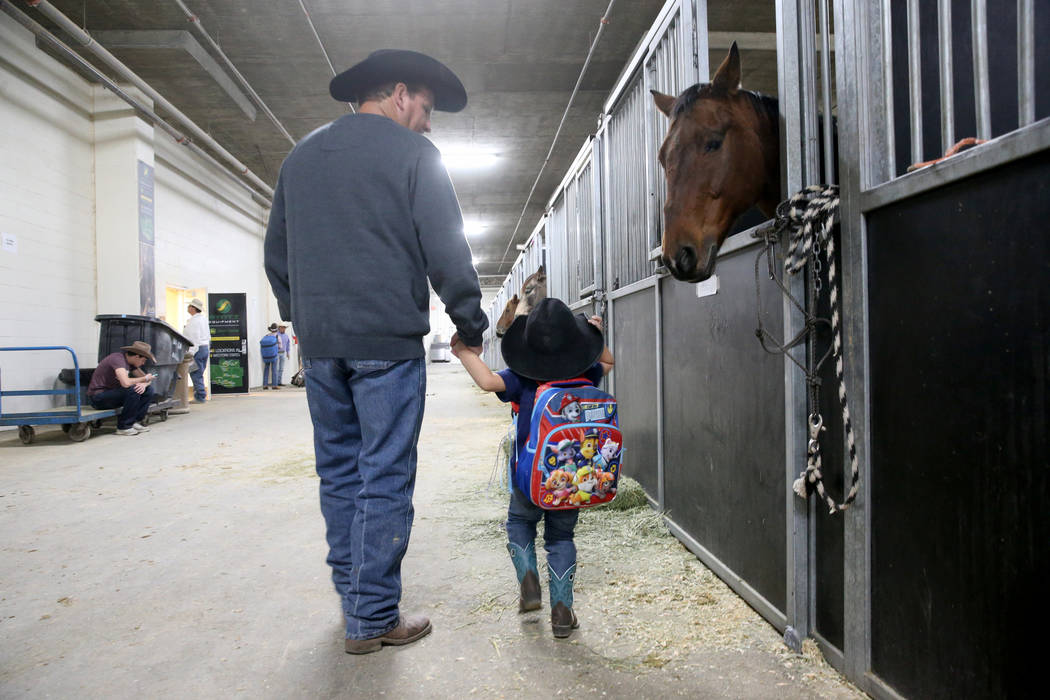 Mike Not Afraid and his grandson, Grayson Spotted Bear, 2, during Indian National Finals Rodeo ...