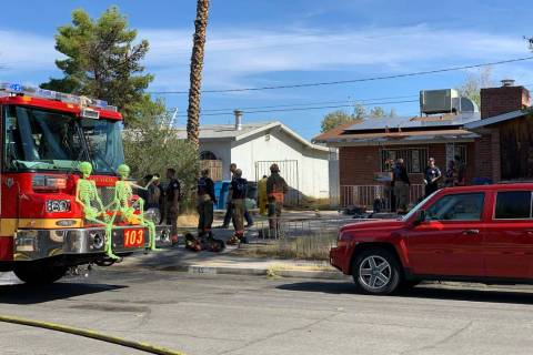 Las Vegas fire crews battle a fire at 241 View Drive, near South Decatur Boulevard and Alta Dri ...