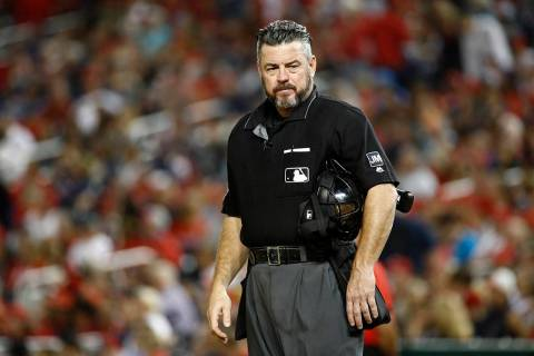 FILE--Umpire Rob Drake stands on the field during a baseball game between the Atlanta Braves an ...