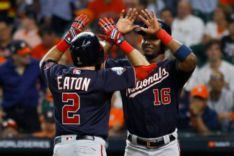 Washington Nationals' Adam Eaton celebrates his two-run home run with Victor Robles during the ...