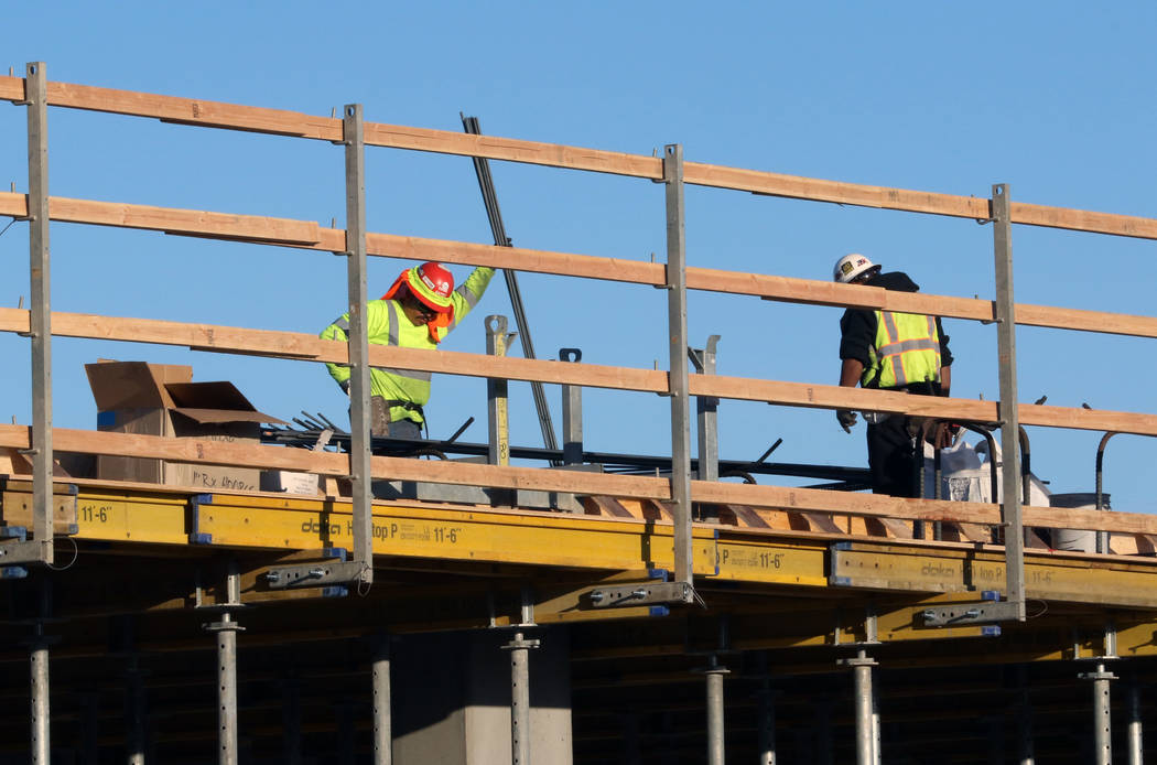 Construction workers at the site of an apartment complex at the southwest corner of Casino Cent ...