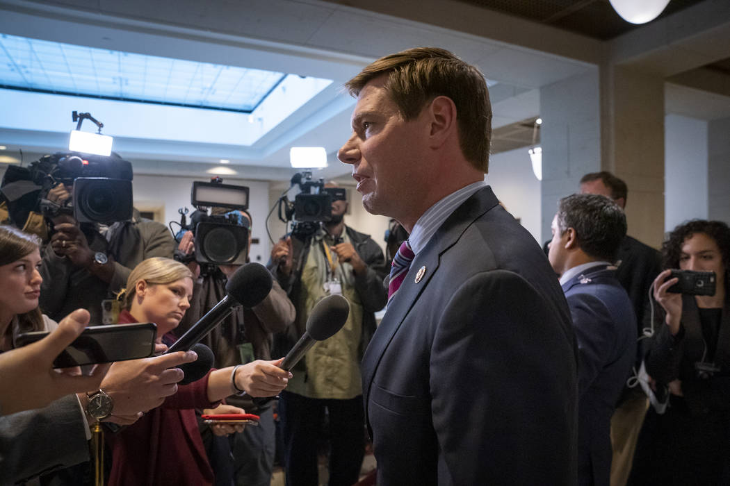 Rep. Eric Swalwell, D-Calif., a member of the House Intelligence Committee, answers questions f ...