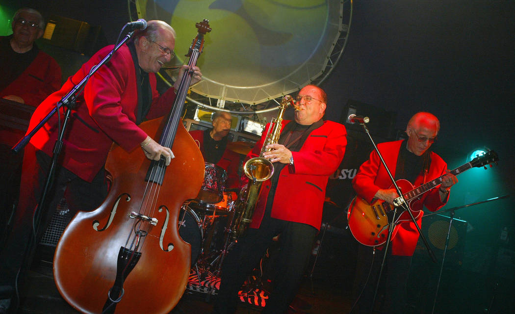 The five surviving members of the rock 'n' roll band Bill Haley & The Comets perform after ...
