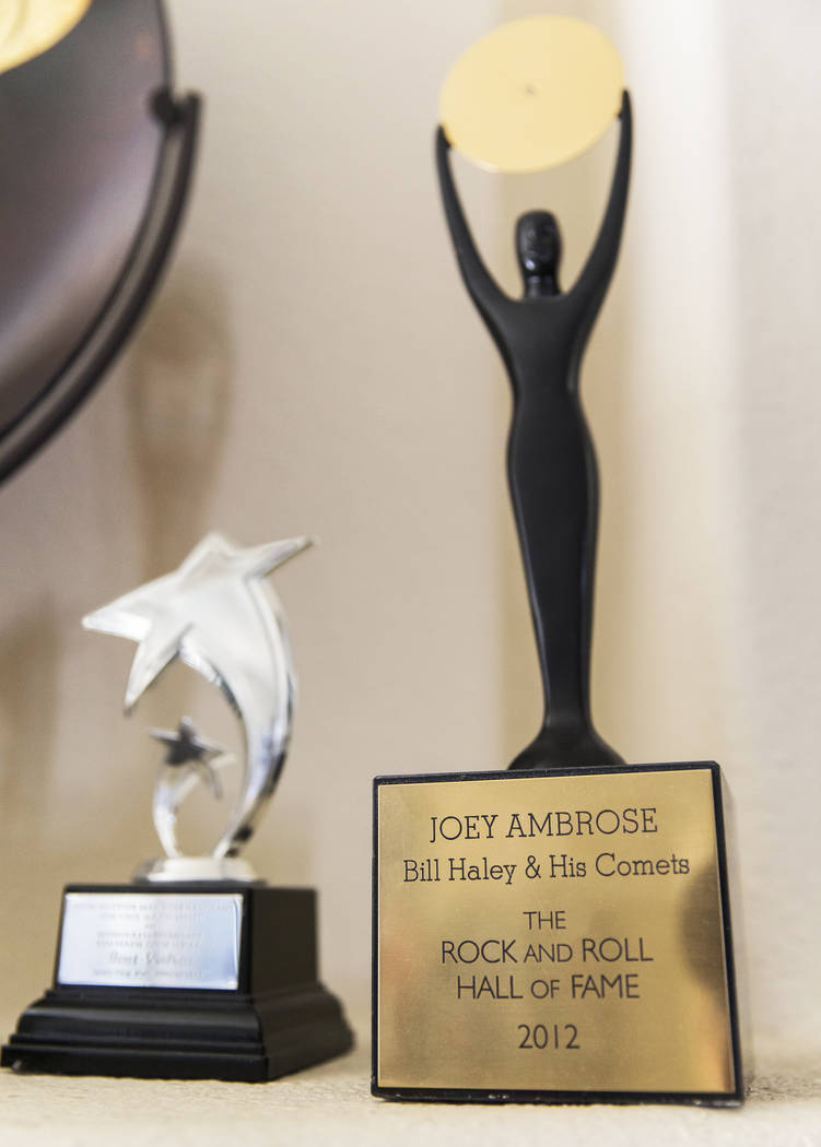 Joe D'Ambrosio's Rock & Roll Hall of Fame statue, right, at his home in Henderson on Friday ...