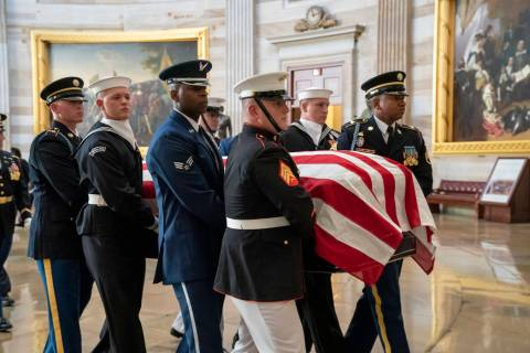 The late Maryland Rep. Elijah Cummings is carried through the Rotunda of the Capitol to lie in ...
