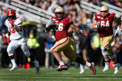 Boston College running back David Bailey (26) carries the ball against North Carolina State dur ...