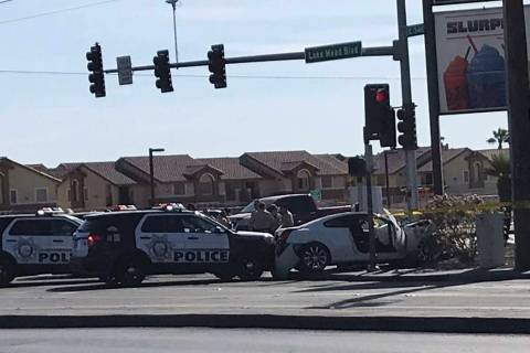 Police investigate an incident at the corner of Lake Mead Boulevard and Pecos Road where a stol ...