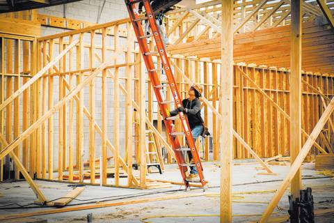 Tonya Harvey RJRealEstate.Vegas This file photo shows a worker at a new-home construction site. ...