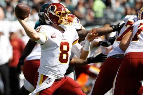 Washington Redskins' Case Keenum in action during the first half of an NFL football game agains ...