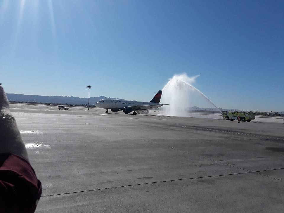 A water cannon salute greets the plane carrying the remains of Seaman 2nd Class Moyses Alfonso ...