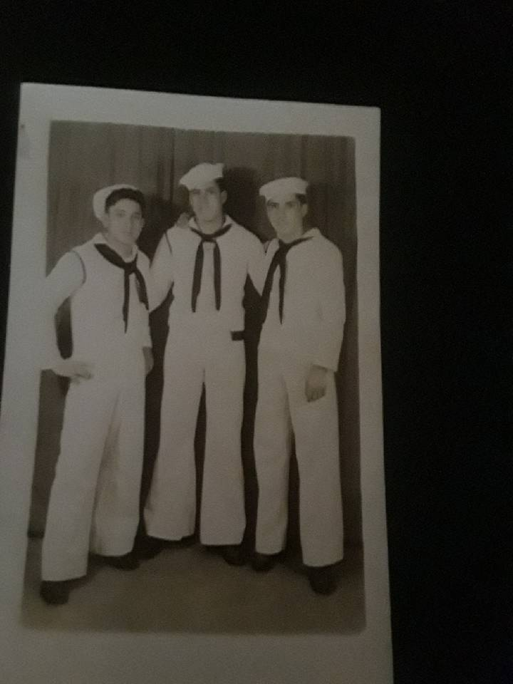 Seaman 2nd Class Moyses Alfonso Martinez, right, and his crewmen during World War II. Martinez' ...