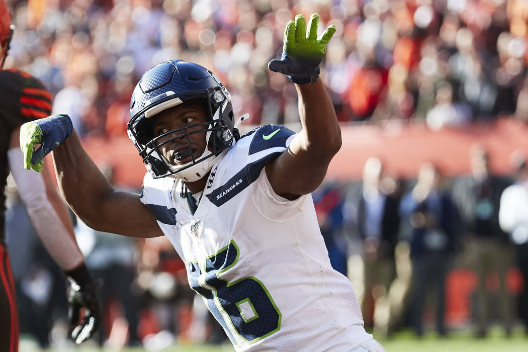 Seattle Seahawks wide receiver Tyler Lockett (16) reacts against the Cleveland Browns during an ...