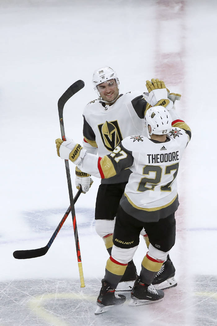 Vegas Golden Knights left wing William Carrier (28) celebrates with Shea Theodore after Theodor ...