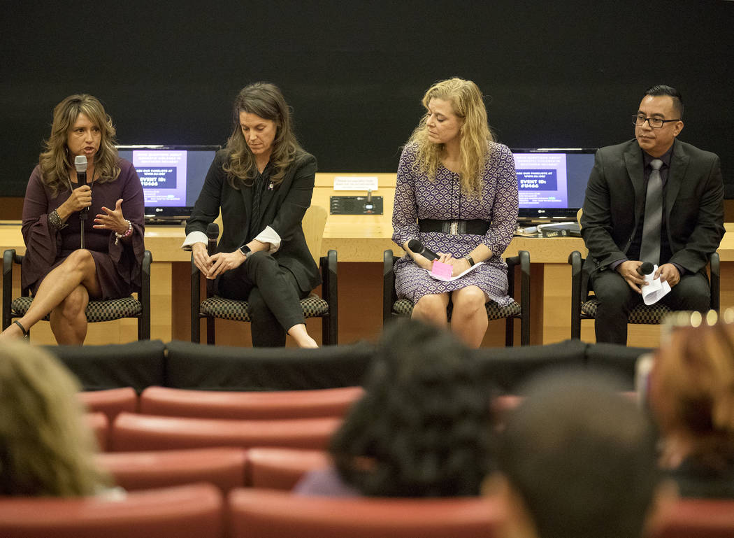 Linda Perez, from left, CEO of The Shade Tree, speaks at a panel discussion about domestic viol ...
