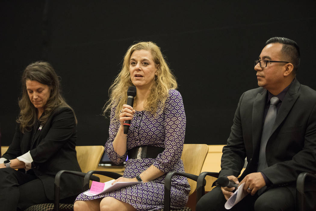 Daniele Staple, executive director of the Rape Criss Center, speaks at a panel discussion about ...