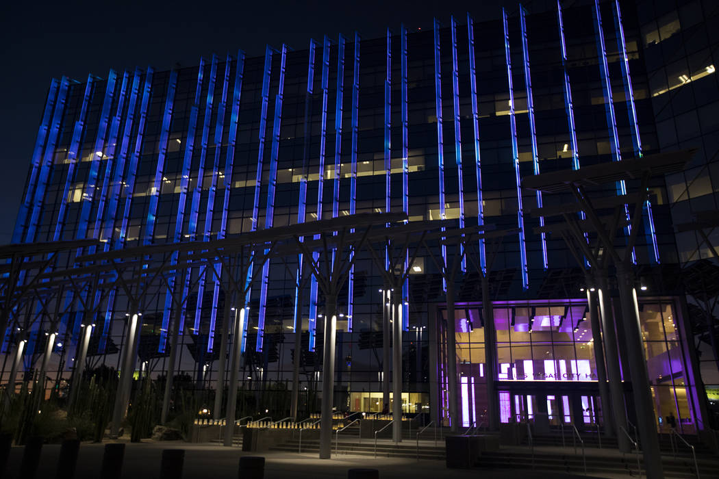 City Hall is lit purple in honor of domestic violence victims in Las Vegas, Thursday, Oct. 24, ...