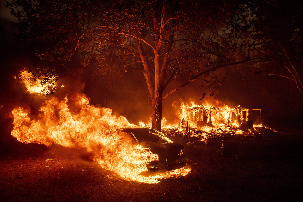 Flames from the Kincade Fire consume a home and car in the Jimtown community of unincorporated ...